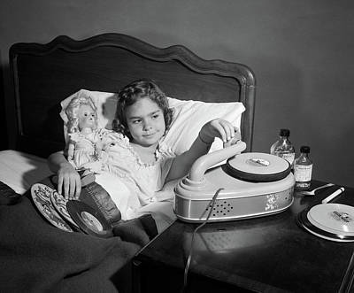 Cough Syrup Photograph - 1950s Girl Sick In Bed Playing Records by Vintage Images