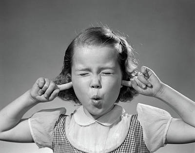 Loud Photograph - 1950s Girl With Fingers In Ears Eyes by Vintage Images