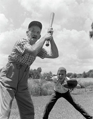 Softball Photograph - 1950s Grandfather At Bat With Grandson by Vintage Images