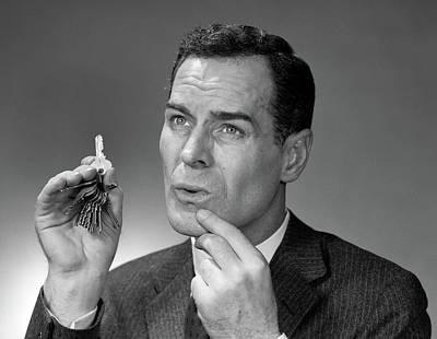 1950s Head Shot Of Man Holding Pair Art Print