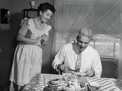 Early Middle Ages Photograph - 1950s Husband Eating Dinner As Wife by Vintage Images