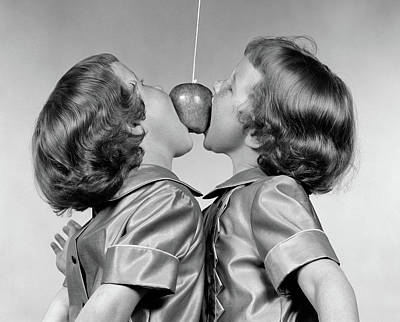 Bite Photograph - 1950s Identical Twin Girls Trying by Vintage Images