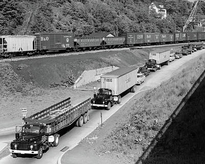 Freight Train Photograph - 1950s Line Of Traffic With Many Trucks by Vintage Images