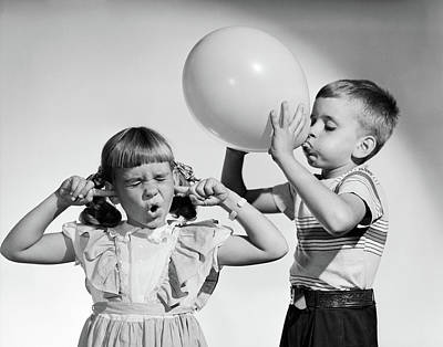 Loud Photograph - 1950s Little Boy Blowing Up Big Balloon by Vintage Images