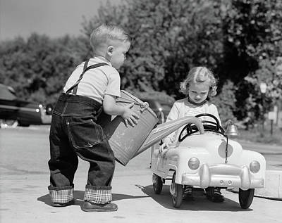 Driving Machine Photograph - 1950s Little Boy Playing Gas Station by Vintage Images