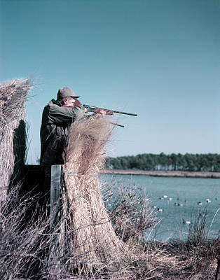 Aliens Photograph - 1950s Man Behind Grass Duck Blind by Vintage Images