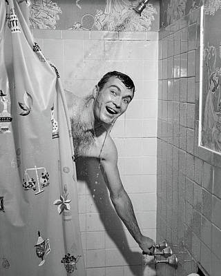 Shower Head Photograph - 1950s Man In Shower Turning On Water by Vintage Images