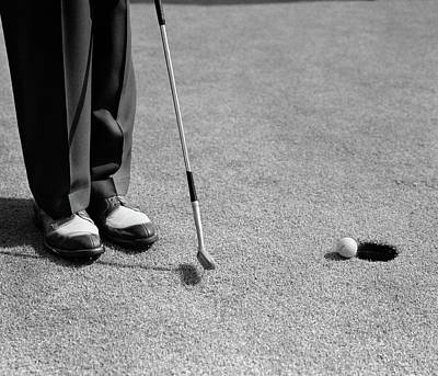 Putt Photograph - 1950s Man Knees Down Putt On Golf Green by Vintage Images