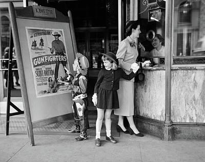 1950s Mother 2 Children Buying Tickets Art Print