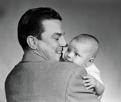 Man Holding Baby Photograph - 1950s Proud Smiling Man Father Back by Vintage Images