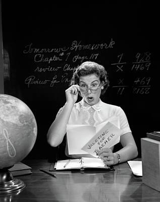 Shock Photograph - 1950s School Teacher At Desk Hand by Vintage Images