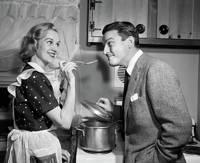 Anticipate Photograph - 1950s Smiling Housewife At Stove Giving by Vintage Images
