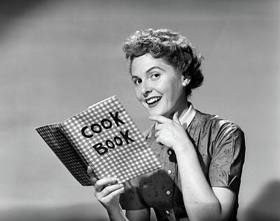 Cookbooks Photograph - 1950s Smiling Woman Holding Cookbook by Vintage Images