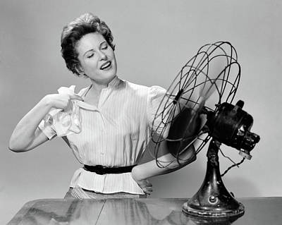 Sweating Photograph - 1950s Woman Cooling With Swivel Fan by Vintage Images