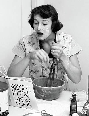 Cookbooks Photograph - 1950s Woman Face Covered Flour Mixing by Vintage Images
