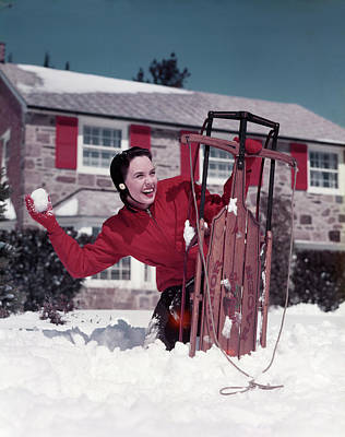 Hiding Photograph - 1950s Woman Hiding Behind Sled Throwing by Vintage Images