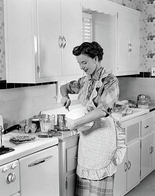 Mixing Bowls Photograph - 1950s Woman Housewife In Kitchen Apron by Vintage Images
