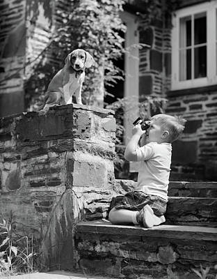 Snap Photograph - 1950s Young Boy Kneeling On Stone by Vintage Images