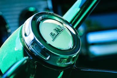 Art Print featuring the photograph 1958 Gmc Suburban Steering Wheel Emblem by Jill Reger