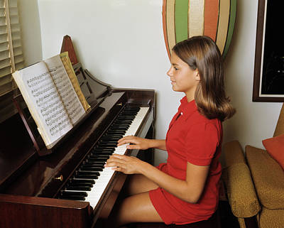 Teenage Girl Photograph - 1960s 1970s Teenage Girl Playing Piano by Vintage Images