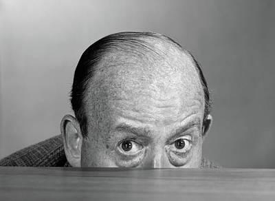 1960s Balding Man Peeking Over Desktop Art Print