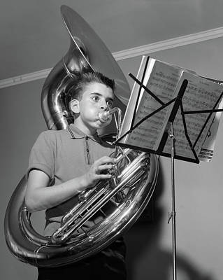 Tuba Photograph - 1960s Boy Playing The Tuba While by Vintage Images