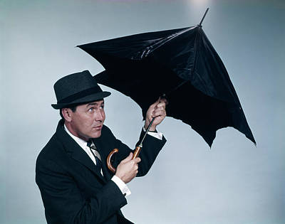 Rain Hat Photograph - 1960s Businessman Wearing Hat Opening by Vintage Images