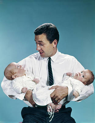 Man Holding Baby Photograph - 1960s Father Holding Twin Babies by Vintage Images