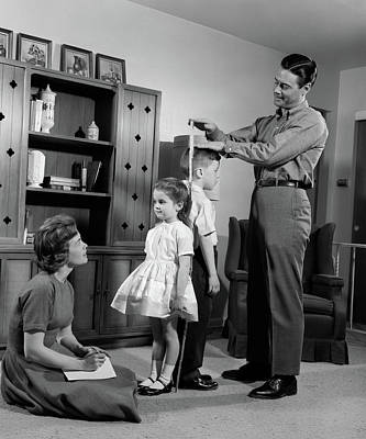 Back To Life Photograph - 1960s Father Measuring Daughter & Son by Vintage Images