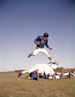 1960s Football Player Running Carrying Art Print