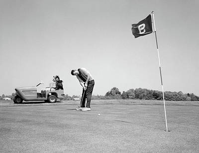 Putt Photograph - 1960s Man Playing Golf Putting Golf by Vintage Images