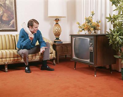 1960s Man Sitting On Sofa Holding Art Print