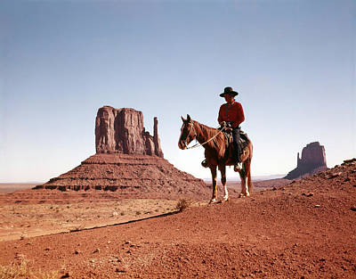 Arid Life Photograph - 1960s Navajo Man On Horse Monument by Vintage Images