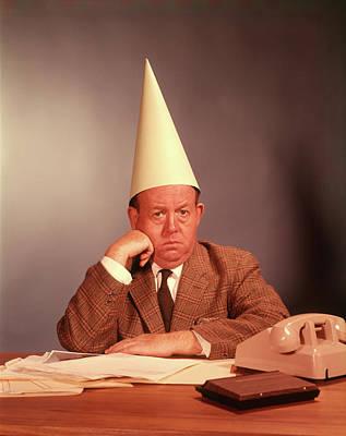 Dunce Cap Photograph - 1960s Sad Depressed Businessman Desk by Vintage Images