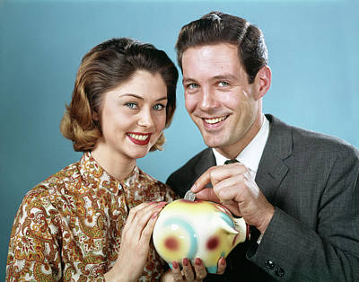 Piggy Bank Wall Art - Photograph - 1960s Smiling Couple Looking At Camera by Vintage Images
