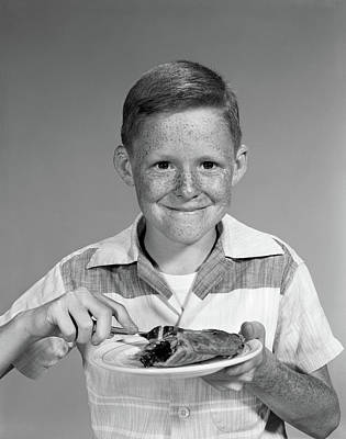 Freckles Photograph - 1960s Smiling Freckle Face Boy Eating by Vintage Images