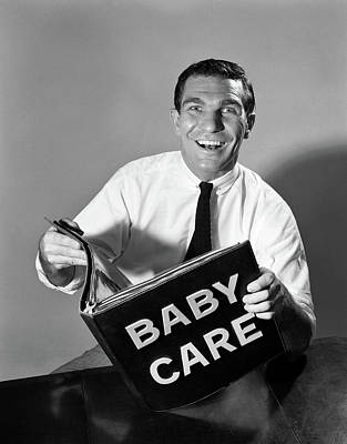Man Holding Baby Photograph - 1960s Smiling Man Father Holding Baby by Vintage Images