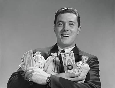 Loot Photograph - 1960s Smiling Man Holding Money Bags by Vintage Images