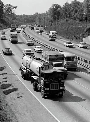Truck Photograph - 1960s Tanker Truck Traveling On Busy by Vintage Images