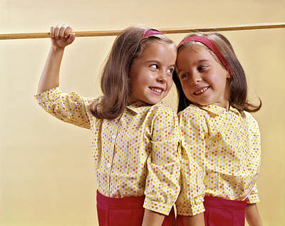 Back To Life Photograph - 1960s Twin Girls Measuring Their Height by Vintage Images