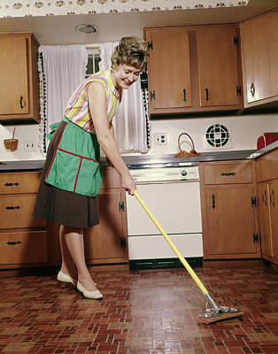1960s Woman In Apron Cleaning Kitchen Art Print