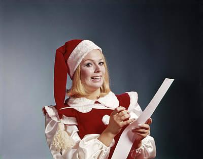 1960s Young Woman In Santa Helper Hat Art Print
