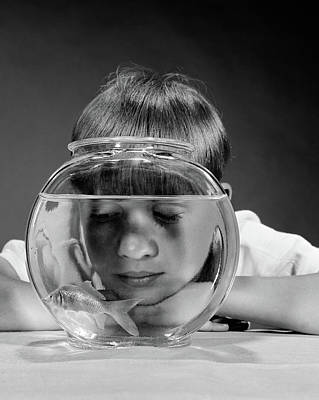 Goldfish Photograph - 1970s Boy Watching Goldfish Swim by Vintage Images