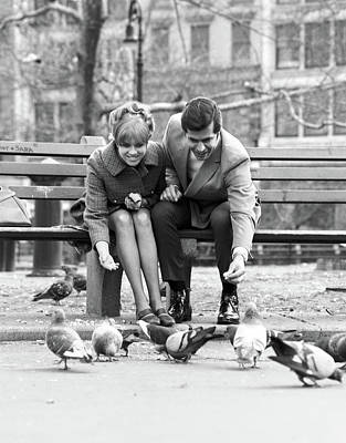 Pigeon Photograph - 1970s Couple On Park Bench Leaning by Vintage Images