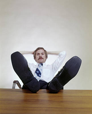 Self-confidence Wall Art - Photograph - 1970s Man Sitting Office Desk Feet by Vintage Images