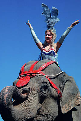 Pachyderm Photograph - 1970s Showgirl Riding Elephant by Vintage Images