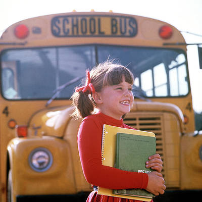 School Bus Photograph - 1970s Smiling Elementary School Girl by Vintage Images
