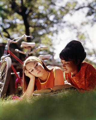 College Girls Wall Art - Photograph - 1970s Two College Women Students Lying by Vintage Images