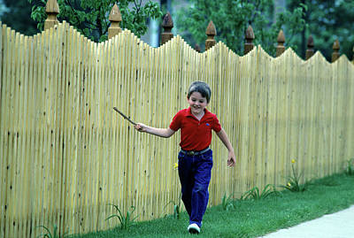 Rattle Photograph - 1980s Smiling Boy Running by Vintage Images