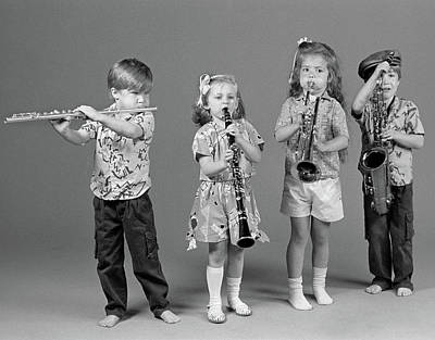 Saxophone Photograph - 1980s Two Boys And Two Girls Playing by Vintage Images